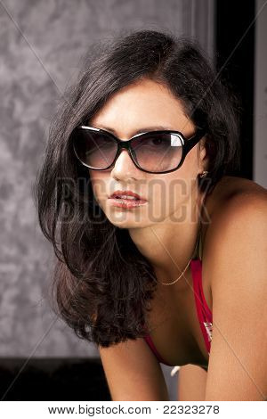 Elegant young lady in sun glasses