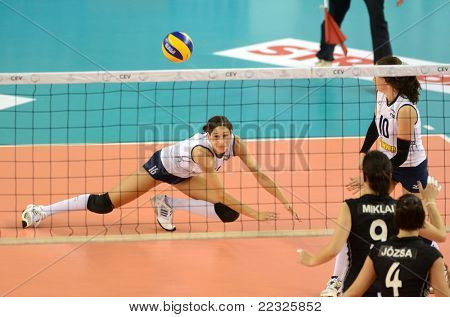 DEBRECEN, HUNGARY - JULY 9: Unidentified players in action a CEV European League woman's volleyball game Hungary (black) vs Israel (white) on July 9, 2011 in Debrecen, Hungary.
