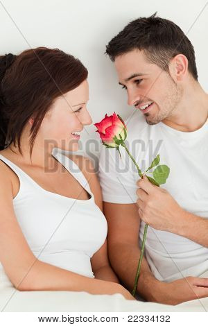 Close up of a cheery couple in their bedroom