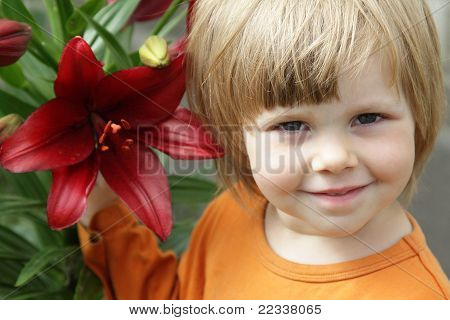 Little Girl With A Red Lily