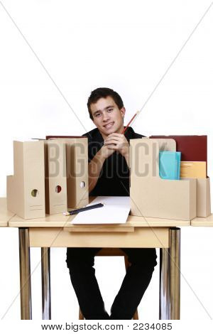 Male Businessman Sitting In Work