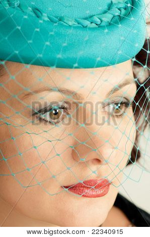 Woman In Green Hat