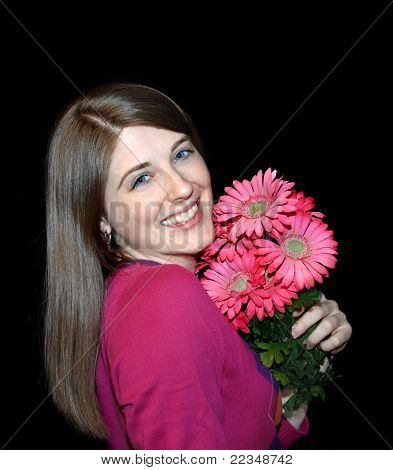 Beaming Woman With Flowers