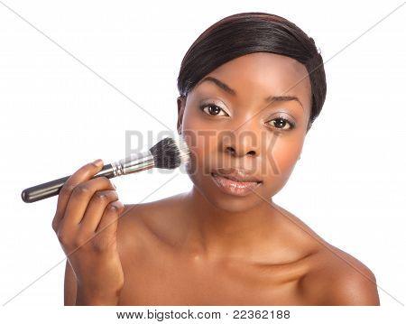Beautiful Black Woman Using Stippling Brush