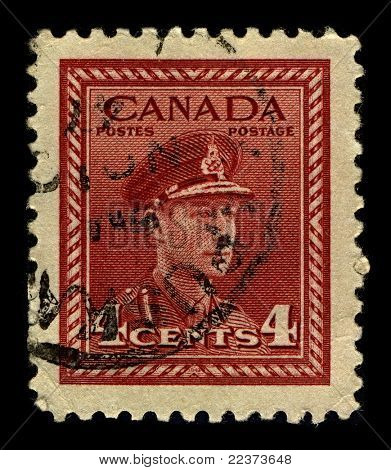 CANADA-CIRCA 1942:A stamp printed in CANADA shows image of George VI  was King of the United Kingdom and the Dominions of the British Commonwealth from 11 December 1936 until his death, circa 1942.