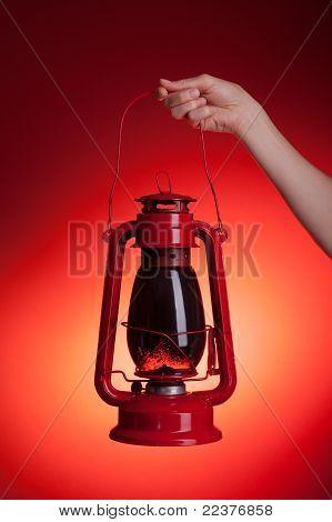 Woman Holding Kerosene Lantern