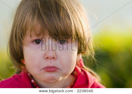 Crying Little Girl Looking At You