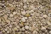 stock photo of fieldstone-wall  - many beach rounded stones making a pattern - JPG