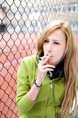 foto of teen smoking  - Teenage girl smoking - JPG