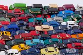 pic of parking lot  - Many colorful cars are lined up in a parking lot - JPG