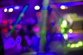 People Dance Sing Have Fun And Relax In A Night Club Blurred Background. Flashes Of Light Beautiful poster
