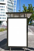 foto of bus-shelter  - An image of a bus stop with a blank bilboard for your advertising situated in front of the turning torso skyscraper in the swedish city of Malmo - JPG