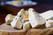 image of penicillium  - A cheese platter featuring blue vein and camembert cheeses - JPG