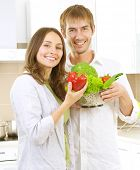 Young Couple Cooking Healthy eating.Diet.Kitchen