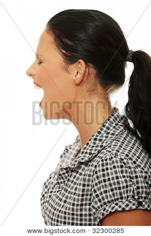 Furious young  woman screaming. Isolated on white