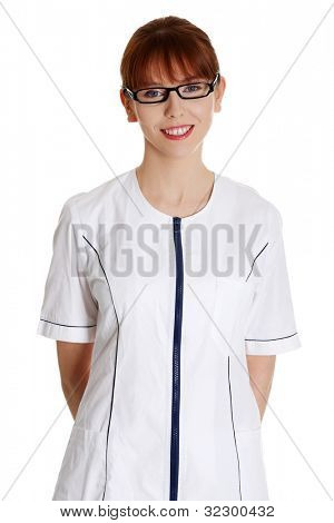 Young woman in health care worker uniform (doctor, beautician). Beauty spa massage therapist woman portrait isolated on white background.