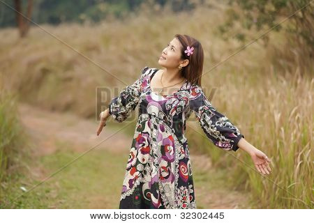 happy woman relaxing in wild tropical nature, thailand