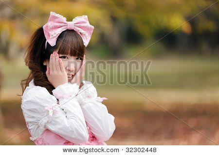 japanese in sweet lolita cosplay in harajuku park, Tokyo