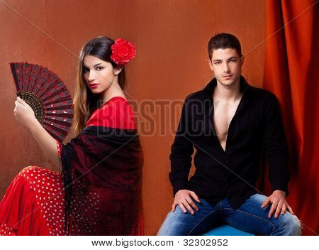 Gypsy flamenco dancer couple from Spain with red rose and spanish hand fan