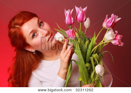 Young woman with lovely tulips