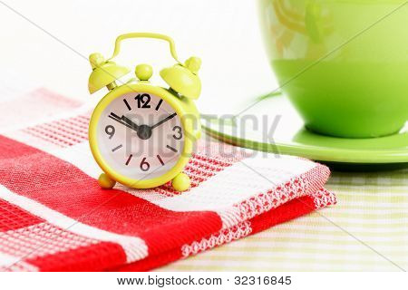 Small clock on the red napkin