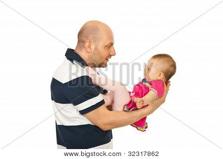 Father Talking With Baby Girl