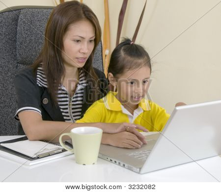 Mom And Daughter With Computer