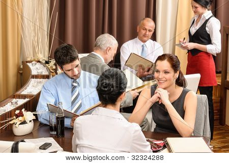 Business lunch executive people looking menu  ordering meal at restaurant