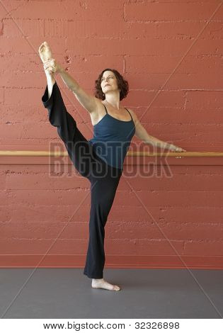 Middle-aged woman in ballet position