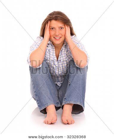 Ein Bild von einer jungen positive Frau sitzen und Lächeln over white background