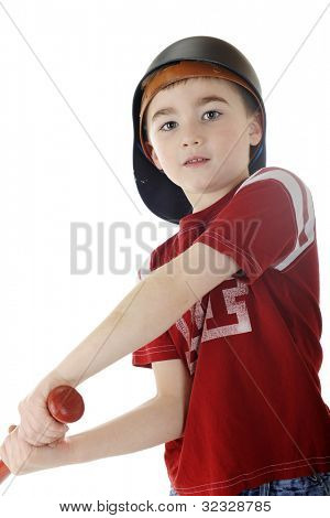 Close-up view of a young elementary baseball player swinging his bat.  On a white background.
