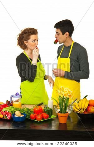Couple Eating Strawberries In Kitchen