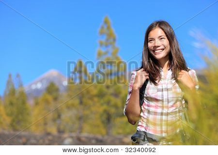 Hiker. Hiking woman portrait of happy female outdoors person during hike in forest on volcano Teide, Tenerife, Canary Islands, Spain, Young mixed race Asian Chinese / Caucasian girl.