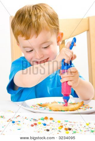 Boy Decorating Baked Biscuits