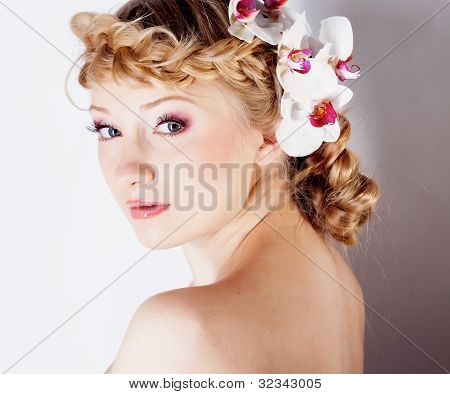 Girl With Orchid Flower In Hair