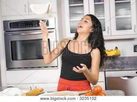 Woman Tossing Pizza Dough