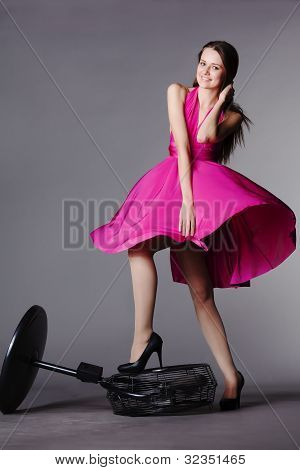 Young Beautiful Girl In Pink Dress On The Fan