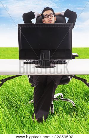 Businessman Relaxing At His Outdoor Office