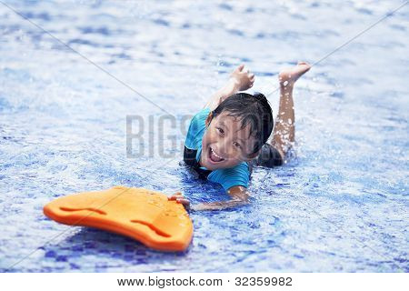 Happy Asian Kid At Swimming Pool