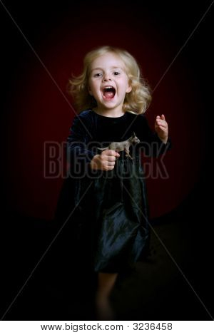 Happy Little Girl In Party Dress With Toy