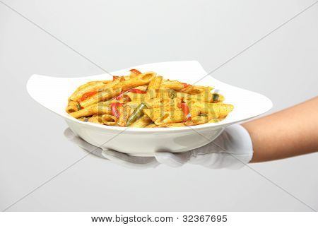 Hand Holding A Bowl Of Pasta