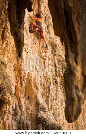 Female Climber Reaching Railay Thailand