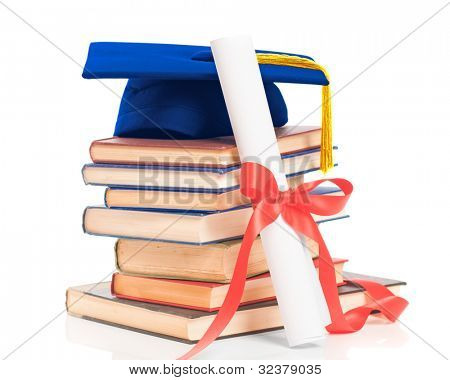 Books with graduation mortar board and diploma scroll on a white background