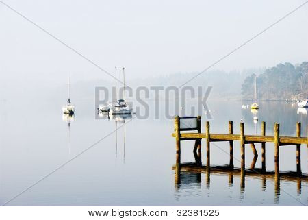 Yachts Moored On A Misty Lake