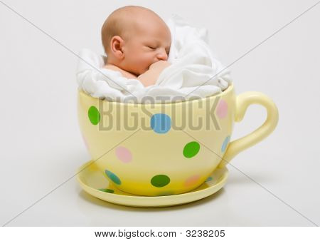 Newborn In Yellow Spotted Cup