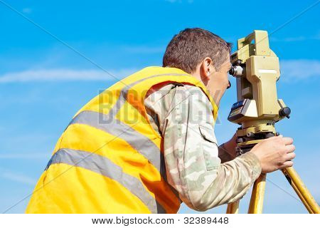Surveyor engineer making measuring with theodolite