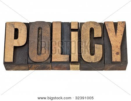 policy  - isolated word in vintage letterpress wood type