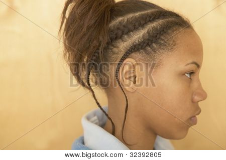 Profile of African girl with cornrows
