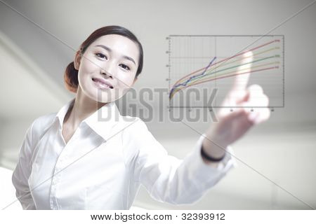 business woman draw  graph on screen