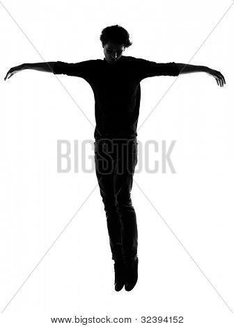 young man silhouette in studio isolated on white background